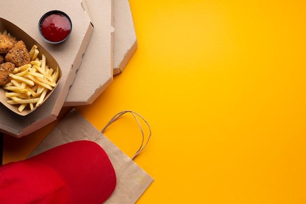 Caixas de pizza plana leigos com cópia-espaço