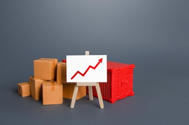 Caixas e contêineres perto do cavalete com gráfico positivo crescimento do volume de transporte de mercadorias