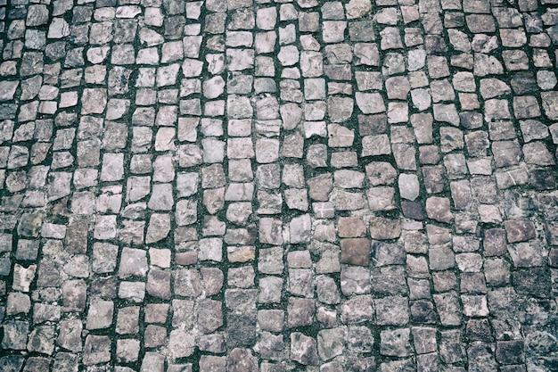 Calçada de granito apedrejado pavimento.