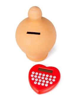 Calculadora e chupeta em forma de coração.