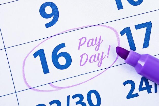 Calendário com círculo de marcador no dia do pagamento de palavra