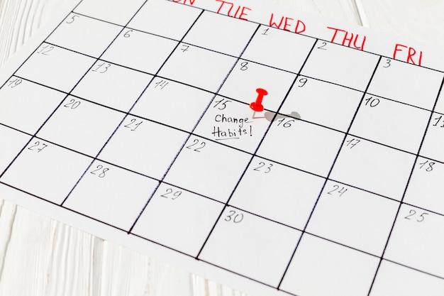 Calendário com marca de mau hábito