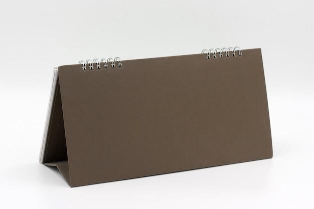 Calendário de mesa em branco sobre branco