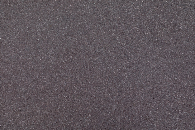 Camada plana de asfalto cinza escuro recém colocado