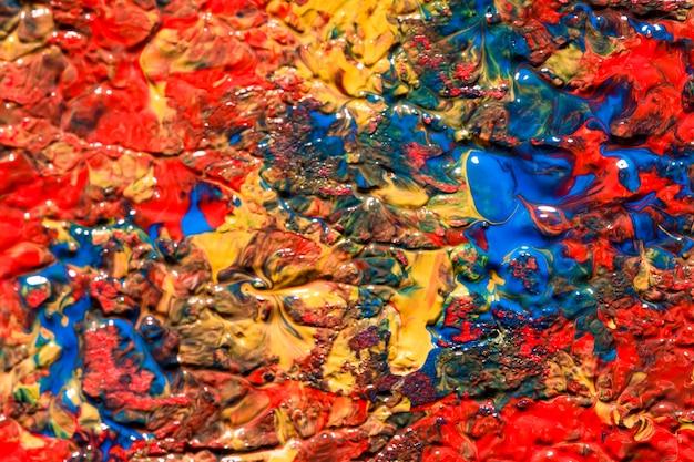 Camada plana de tinta multicolorida na superfície