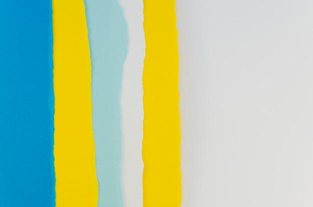 Camadas verticais de papel azuis e amarelas