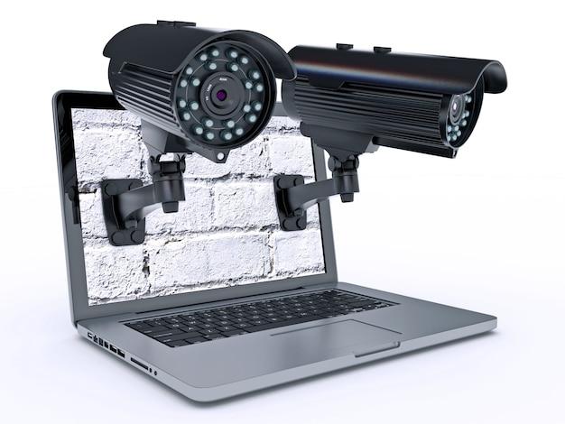 Câmera de vigilância por vídeo e laptop