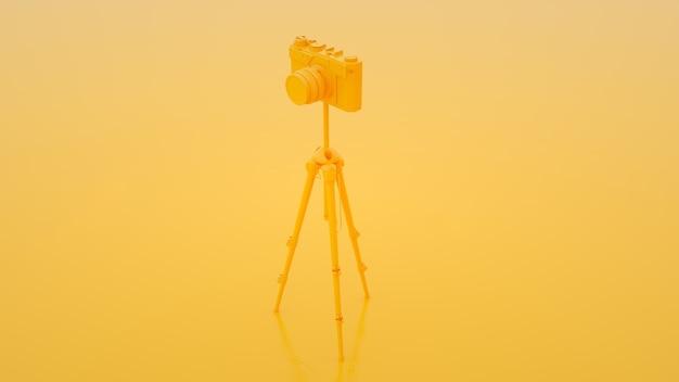 Câmera fotográfica e tripé em fundo amarelo