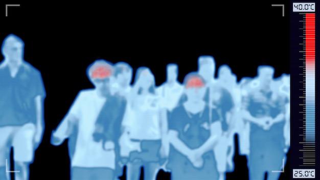 Câmera infravermelha thermoscan que digitaliza pessoas com febre, mostrando alerta de cor vermelha em alta temperatura corporal para controle de surtos