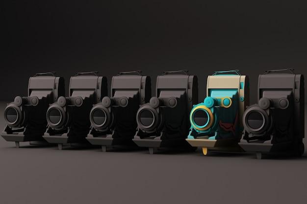 Câmera vintage colorida cercando por câmera vintage preta em um fundo preto.