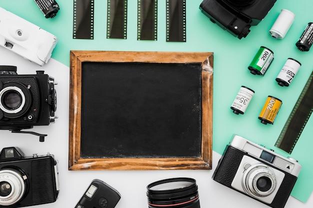 Câmeras e filme em torno de lousa
