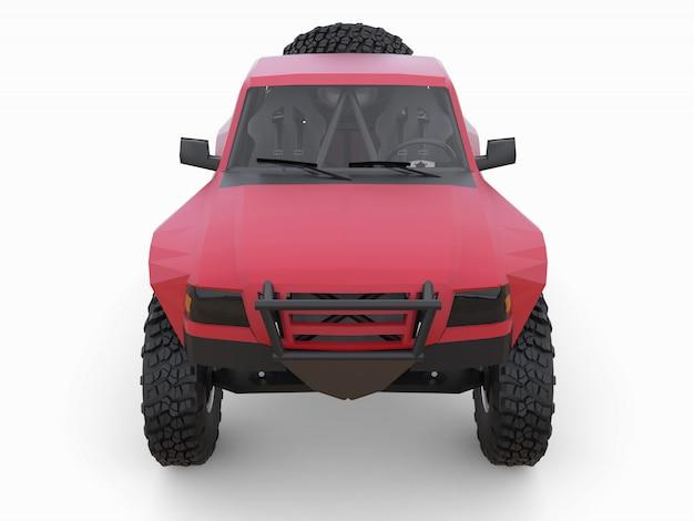 Caminhão de corrida esportivo vermelho mais preparado para o terreno do deserto.