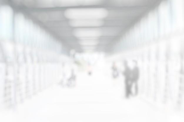 Caminho desfocado abstrato cinza branco para o projeto de pano de fundo