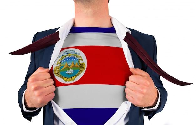 Camisa de abertura de homem de negócios para revelar a bandeira de costa rica