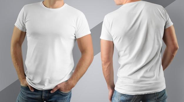 Camiseta branca no homem musculoso na parede cinza. vista frontal e traseira.