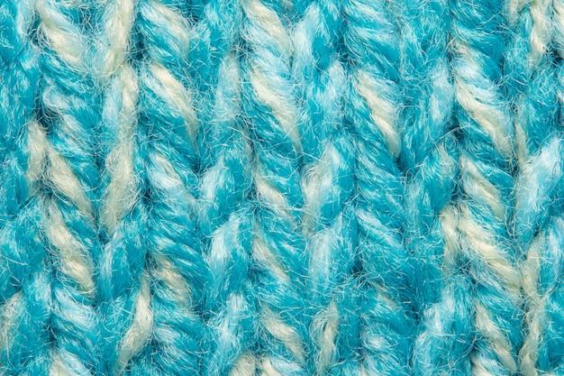 Camisola de malha azul textura macro plano de fundo