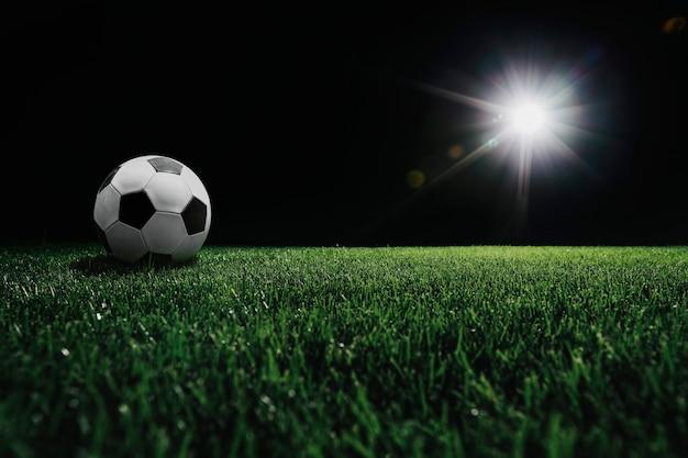 Campo de futebol com holofote brilhante