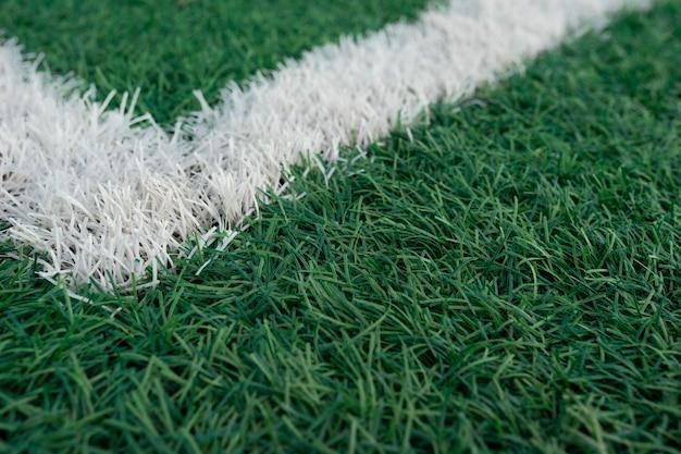 Campo de futebol gramado com listras