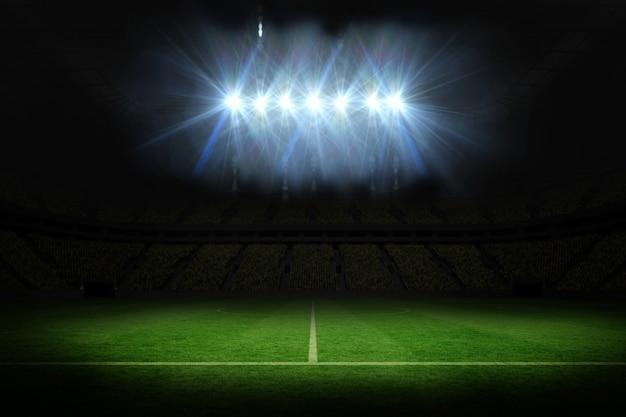 Campo de futebol sob holofotes