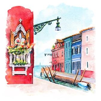 Canal e casas iluminadas na ilha de burano, veneza, itália