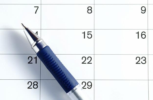 Caneta e calendário