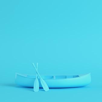 Canoa com remos em fundo azul brilhante