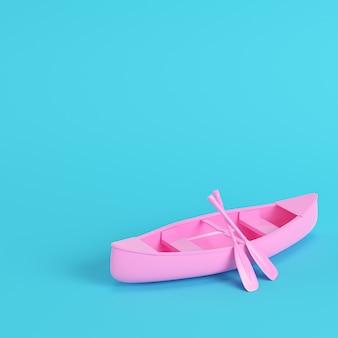 Canoa rosa com remos em fundo azul brilhante