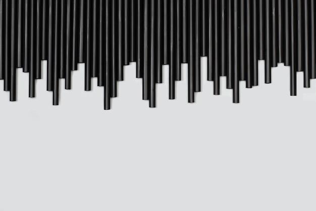 Canudo de plástico preto em forma de gráfico de som em cinza