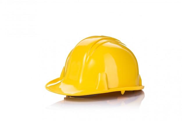 Capacete de segurança amarelo novo da construção.