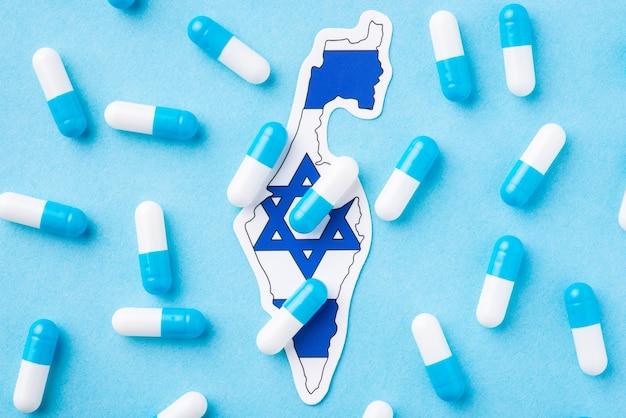 Cápsulas azuis e brancas na bandeira de israel. propagação de muitas doenças, enfermidades entre a população de israel