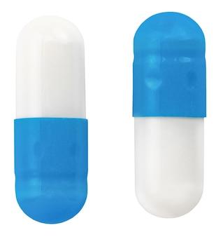 Cápsulas de comprimidos isoladas em branco