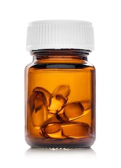 Cápsulas de óleo de peixe em frasco de vidro castanho