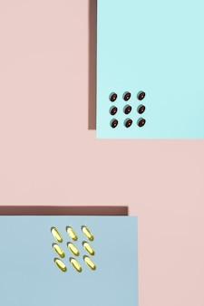 Cápsulas de vitamina, comprimidos de lecitina e pílula de ômega no conceito de sombras da tendência de fundo rosa e azul