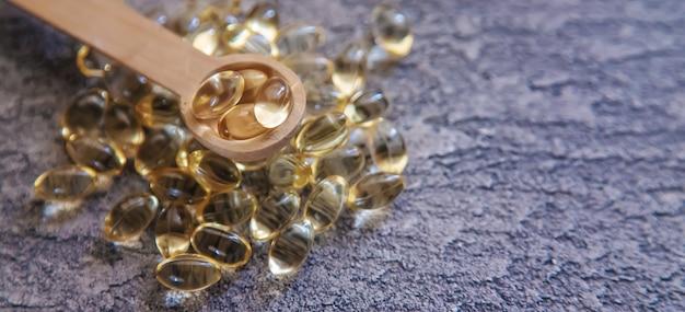 Cápsulas de vitamina e. foco seletivo. natureza médica dos cuidados de saúde