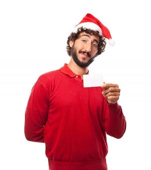 Cara com chapéu de santa e um cartão vazio