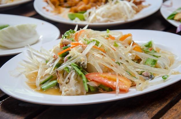 Caranguejo de salada de mamão
