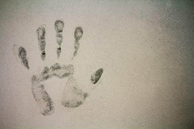 Carimbo de impressão da mão em fundo de textura