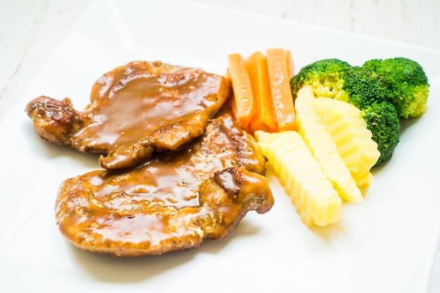 Carne de porco bife