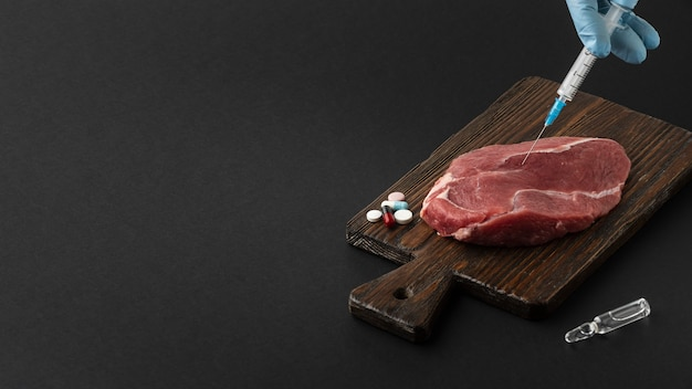 Carne e seringa de alta visão