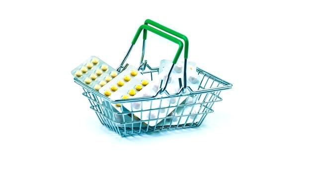 Carrinho da loja com comprimidos em um fundo branco. conceito de compra de drogas.