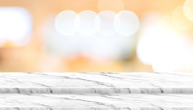 Carrinho de comida de mesa de mármore de etapa vazia com borrão café restaurante fundo bokeh luz
