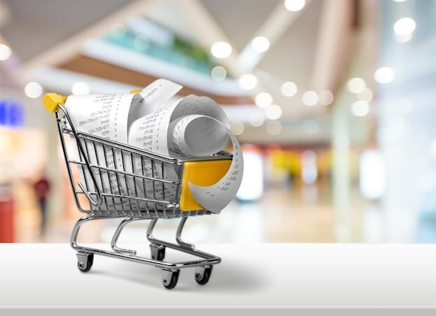 Carrinho de compras cheio de contas no fundo