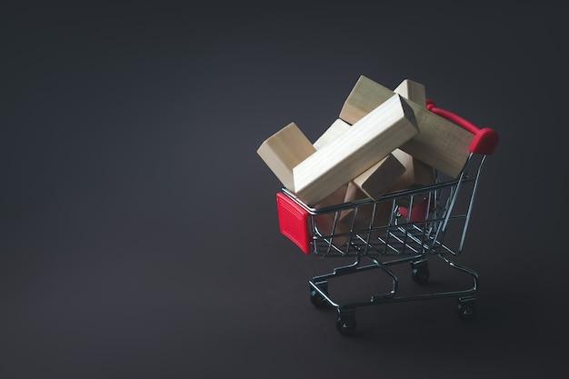 Carrinho de compras com blocos para renovação da casa. estilo de maquete. compras, vendas, finanças e negócios