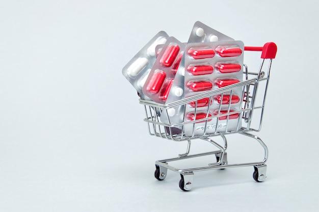 Carrinho de compras com pílulas