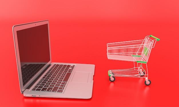 Carrinho de compras na frente de um laptop no vermelho