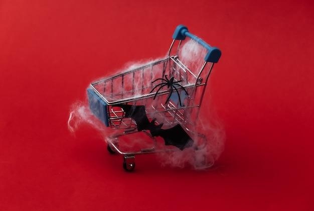 Carrinho de compras na web em um vermelho. tema de halloween.