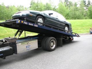 Carro em carro, caminhão de reboque