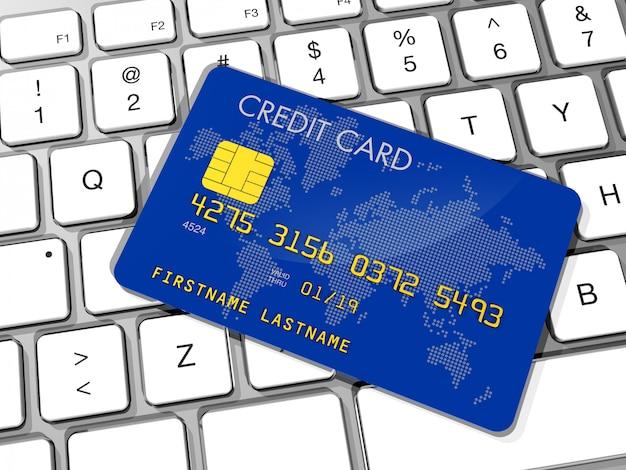 Cartão de crédito azul em um teclado de computador