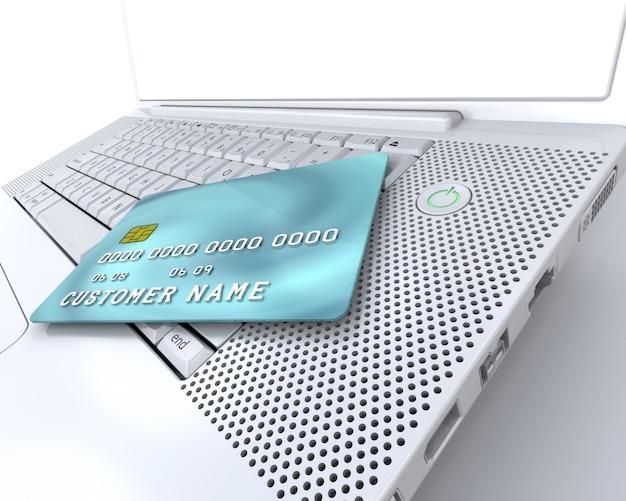 Cartão de crédito genérico no computador que descreve compras pela internet
