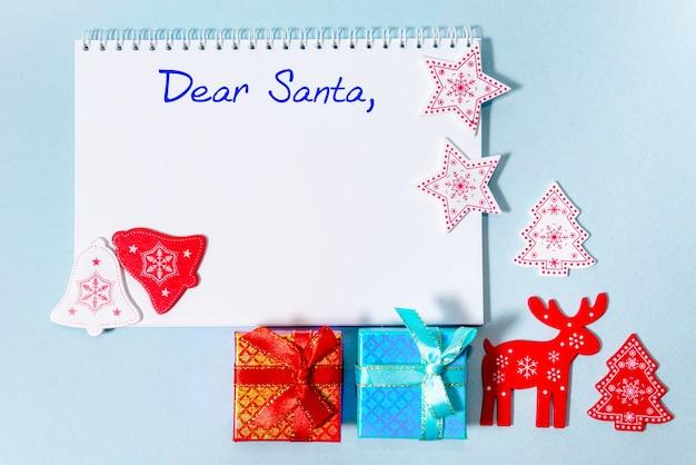 Cartão de desejo de rotulação escrito para querido papai noel. ideia de natal, decoração de ano novo para feriados de dezembro, fundo de cartões comemorativos
